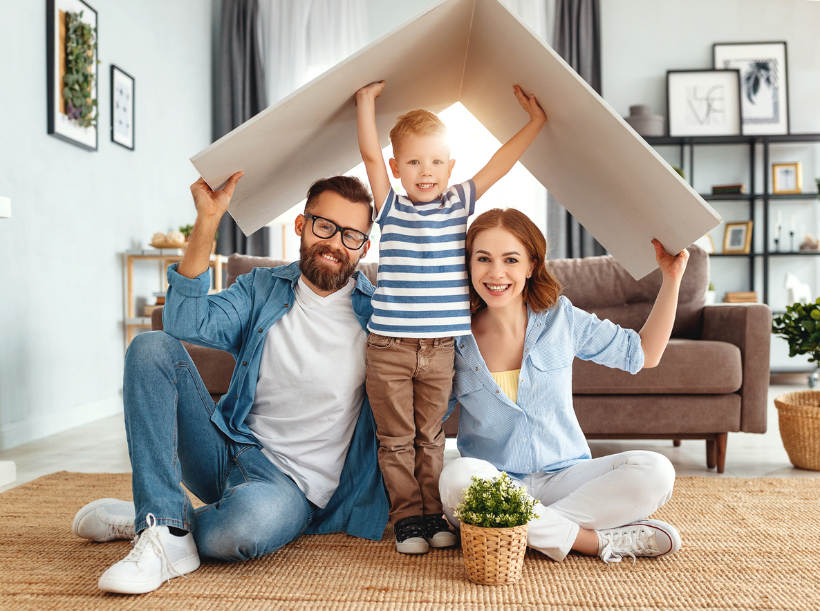 concept housing   young family. Mother father and child in new house with  roof at home